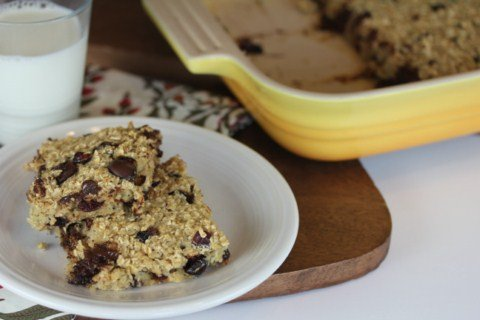 orange cranberry baked oatmeal in a yellow dish