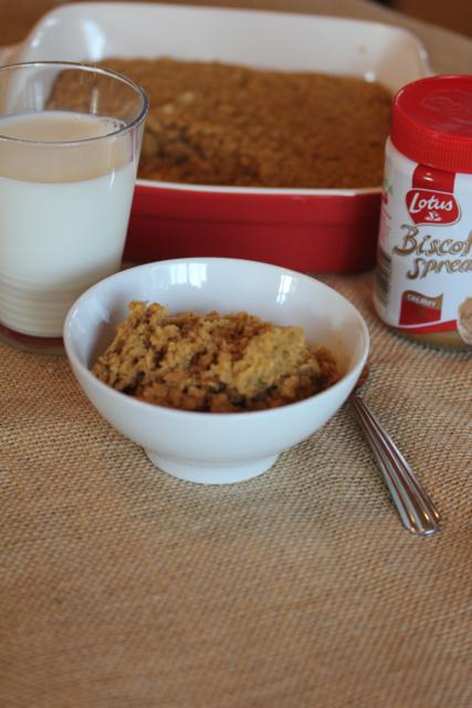 baked oatmeal in a white bowl with milk and biscoff
