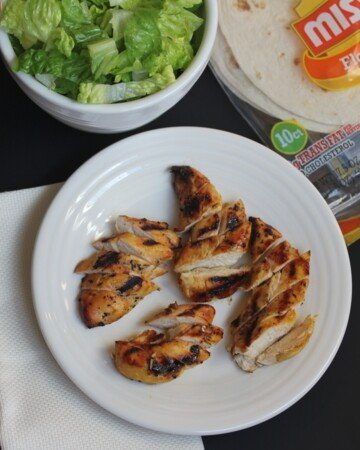 grilled honey mustard chicken on a plate with lettuce