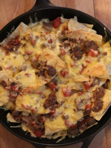 chili nachos in cast iron pan