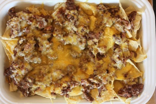 sausage nachos in white pan