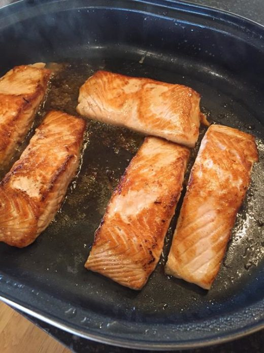 salmon cooking in bacon grease