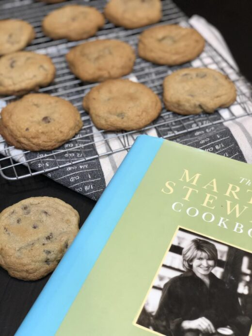 Cookies on a cooling rack next to a Martha Stewart Cookbook