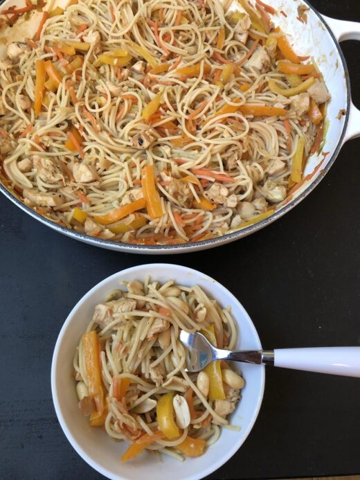 Chicken-Peanut-Noodles in white bowl with fork