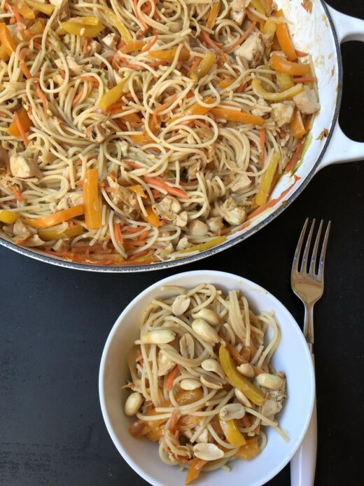 Chicken Peanut Noodles Recipe in white pan and white bowl